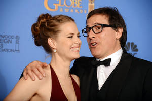 "Photo - Amy Adams, left, and David O. Russell, winners of the award for best motion picture - comedy or musical for ""American Hustle"" pose in the press room at the 71st annual Golden Globe Awards at the Beverly Hilton Hotel on Sunday, Jan. 12, 2014, in Beverly Hills, Calif. (Photo by Jordan Strauss/Invision/AP)"