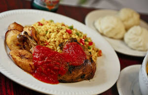 Photo - Do'do' with iy'an is a combination of fried rice and roasted chicken with a spicy homemade tomato sauce. Photo by Chris Landsberger, The Oklahoman <strong>CHRIS LANDSBERGER - CHRIS LANDSBERGER</strong>