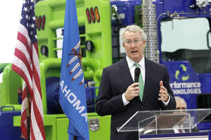 photo - Chesapeake Energy Corp. CEO Aubrey McClendon speaks Friday during the groundbreaking ceremony for the new Radio Road and Interstate 40 interchange in El Reno. The ceremony was held at Performance Technologies LLC, an affiliate of Chesapeake Energy Corp. Photo By Steve Gooch, The Oklahoman