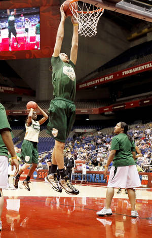 photo - Baylor's Brittney Griner dunks the ball during practice Sunday. The 6-foot-8 freshman says she does a lot of clothes shopping on the Internet, and knows she won't be fitting into a Ferrari anytime soon. Photo by Bryan Terry, The Oklahoman
