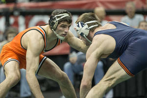 Photo - OSU's Tyler Caldwell, left, competes at the 2013 NCAA Wrestling Championship in Des Moines, Iowa. PHOTO PROVIDED BY OKLAHOMA STATE MEDIA RELATIONS
