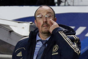 photo -   On his first game in charge of the club Chelsea's interim head coach Rafael Benitez, gestures during the English Premier League soccer match between Chelsea and Manchester City at Stamford Bridge stadium in London, Sunday, Nov. 25, 2012. (AP Photo/Matt Dunham)