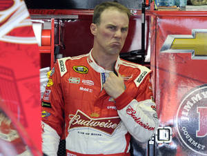 Photo - Kevin Harvick reacts as he talks to crew members during a NASCAR Sprint Cup series auto race practice at Darlington Speedway in Darlington, S.C., Friday, April 11, 2014. (AP Photo/Mike McCarn)