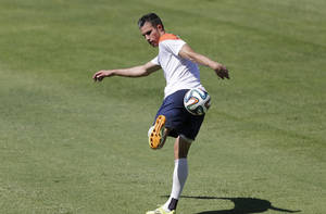 Photo - Robin van Persie of the Netherlands, kicks the ball during their official training session in Fortaleza, Brazil, Saturday, June 28, 2014.  Netherlands will play Group A runner-up Mexico in the second round on Sunday in Fortaleza.(AP Photo/Wong Maye-E)