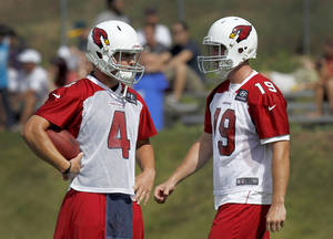 photo -   FILE -In this July 25, 2012, file photo, Arizona Cardinals quaterbacks Kevin Kolb (4) and John Skelton (19) wait for their turn during a drills at the NFL football training camp at Northern Arizona University in Flagstaff, Ariz. Kolb led the Cardinals to victories in their first three games. Soon, coach Ken Whisenhunt will have a decision to make once Skelton, who beat out Kolb for the quarterback's job in the preseason, is ready to healthy enough to play again. (AP Photo/Ross D. Franklin, File)
