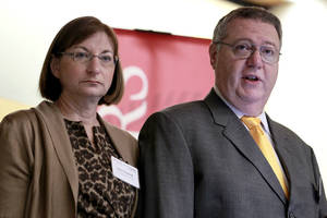 Photo -   FILE - Joseph Clementi, right, and his wife Jane Clementi open a symposium on use and misuse of social media at Rutgers University, in this Nov. 14, 2011 file photo taken in Piscataway, N.J. The parents of a Rutgers University student who killed himself after his roommate used a webcam to see him kissing another man have decided not to sue anyone. Their family attorney Paul Mainardi told the Star-Ledger of Newark Thursday Oct. 4, 2012 they are devoting their energies to the foundation that they established in their son's name. (AP Photo/Julio Cortez, File)