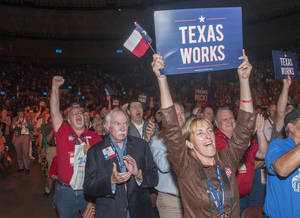 Photo - Delegates to the Texas GOP Convention cheer for Gov. Rick Perry after his speech in Fort Worth, Texas on Thursday, June, 5, 2014. In his address, the longest-serving governor in the state's history focused more on the future and national issues than his political legacy at home. (AP Photo/Rex C. Curry)