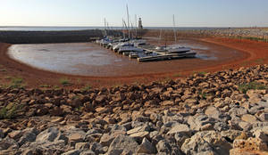 Photo - Boats rest in mud in a cove on the east side of Lake Hefner because of low water levels caused by drought in Oklahoma City, Monday, Oct. 3, 2011. Photo by Nate Billings, The Oklahoman  ORG XMIT: KOD