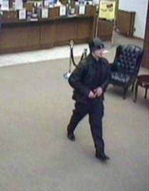 Photo -  Surveillance photo of a suspect who attempted to rob a bank Thursday morning in Midwest City. Photo provided  <strong> -  Photo provided by the FBI </strong>