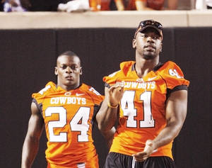 Photo - Oklahoma State linebacker Orie Lemon, right, said having to sit out last year made him love football even more. PHOTO BY DOUG HOKE, THE OKLAHOMAN