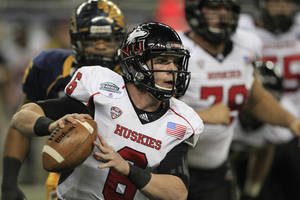 Photo - Northern Illinois quarterback Jordan Lynch (6) scrambles during the first quarter of the Mid-American Conference championship NCAA college football game against Kent State, Friday, Nov. 30, 2012. (AP Photo/Carlos Osorio)