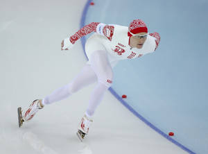 Photo - Russia's Ivan Skobrev competes in the men's 1500-meters race at the Adler Arena Skating Center at the 2014 Winter Olympics, Saturday, Feb. 15, 2014, in Sochi, Russia. (AP Photo/Pavel Golovkin)