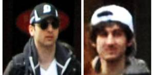 Photo - This combo of photos released by the FBI early Friday April 19, 2013, shows what the FBI is calling suspects number 1, left, and suspect number 2, right,  walking through the crowd in Boston on Monday, April 15, 2013, before the explosions at the Boston Marathon. (AP Photo/FBI)