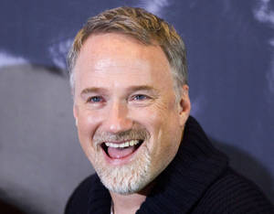 "Photo - In this photo taken Jan. 5, 2012, U.S. director David Fincher smiles during a photo call for the movie ""The Girl with the Dragon Tattoo""in Berlin, Germany. The Walt Disney Studios will film a new version of ""20,000 Leagues Under the Sea"" in Australia after the country agreed to pay it 21.6 million Australia dollars ($22.6 million) to film the movie there. The inducement announced Tuesday, April 2, 2013, is the biggest ever paid by an Australian government to bring in a Hollywood production. Fincher will direct the Jules Verne science fiction classic, said Disney Asia-Pacific spokeswoman Alannah Hall-Smith. (AP Photo/Gero Breloer)"