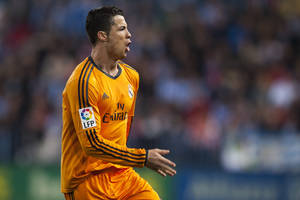 Photo - Real Madrid's Cristiano Ronaldo celebrates scoring the opening goal during a Spanish La Liga soccer match at La Rosaleda stadium in Malaga, Spain, Saturday March 15, 2014. (AP Photo/Daniel Tejedor)