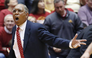 Photo - Texas Tech  coach Tubby Smith argues about an offensive foul call against his team late the second half of an NCAA college basketball game against Iowa State at Hilton Coliseum in Ames, Iowa, Saturday, Feb. 15, 2014. Iowa State won 70-64. (AP Photo/Justin Hayworth)