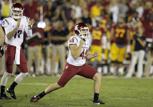 Photo - Washington State kicker Andrew Furney celebrates after kicking the winning field goal during the second half of an NCAA college football game against Southern California in Los Angeles, Saturday, Sept. 7, 2013. Washington State defeated Southern California 10-7 for its first victory at the Coliseum in 13 years. (AP Photo/Chris Carlson)