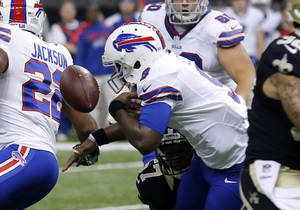 Photo - Buffalo Bills quarterback Thad Lewis (9) fumbles during the first half of an NFL football game against the New Orleans Saints in New Orleans, Sunday, Oct. 27, 2013. (AP Photo/Bill Haber)