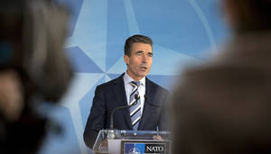 Photo - NATO Secretary General Anders Fogh Rasmussen speaks during a media conference at NATO headquarters in Brussels Sunday, March 2, 2014. NATO is calling emergency talks on Sunday regarding the escalating crisis in Ukraine. (AP Photo/Virginia Mayo)