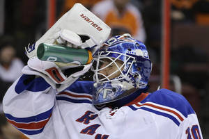 Photo - New York Rangers goalie Henrik Lundqvist, of Sweden, cools off during the second period of an NHL hockey game against the Philadelphia Flyers, Thursday, Jan. 24, 2013, in Philadelphia. (AP Photo/Matt Slocum)