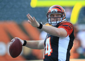 Photo -   FILE - In this Aug. 23, 2012 file photo, Cincinnati Bengals quarterback Andy Dalton warms up prior to an NFL football game against the Green Bay Packers, in Cincinnati. Dalton and A.J. Green made the Pro Bowl together in their first go-around. There will be a lot more on them this time around. (AP Photo/Al Behrman, File)