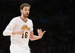 Photo - Los Angeles Lakers center Pau Gasol argues a call while playing against the Oklahoma City Thunder during the second half of an NBA basketball game in Los Angeles, Sunday, March 9, 2014. The Lakers won 114-110. (AP Photo/Danny Moloshok)