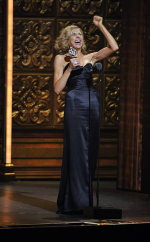 "Photo -   Nina Arianda accepts the Tony for leading actress in a play for ""Venus in Fur,"" at the 66th Annual Tony Awards on Sunday June 10, 2012, in New York. (Photo by Charles Sykes /Invision/AP)"