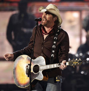 FILE - In this April 3, 2011 file photo, country singer Toby Keith performs at the 46th Annual Academy of Country Music Awards in Las Vegas. Keith has had his gall bladder removed and was forced to reschedule his Aug. 2, 2012 show at Fort McCoy in Sparta, Wis. That concert date has been rescheduled to Aug. 30. (AP Photo/Julie Jacobson, file)