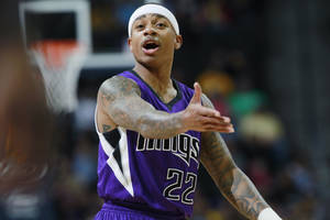 Photo - Sacramento Kings guard Isaiah Thomas directs his teammates as the Kings face the Denver Nuggets in the first quarter of an NBA basketball game in Denver, Sunday, Feb. 23, 2014. (AP Photo/David Zalubowski)