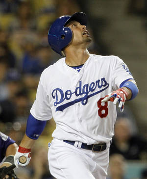 Photo -   The Los Angeles Dodgers' Shane Victorino watches his popup fly to first base, the final out in a 2-0 loss to the Colorado Rockies in a baseball game at Dodger Stadium in Los Angeles Monday, Aug. 8, 2012. (AP Photo/Reed Saxon)