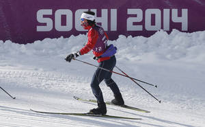 Photo - Norway's Marit Bjoergen trains on the cross country slope prior to the 2014 Winter Olympics, Wednesday, Feb. 5, 2014, in Krasnaya Polyana, Russia. (AP Photo/Matthias Schrader)