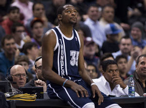 Photo - Oklahoma Thunder forward Kevin Durant looks up after being called on a technical foul against the Toronto Raptors during the first half of an NBA basketball game in Toronto on Friday, March 21, 2014. (AP Photo/The Canadian Press, Nathan Denette)