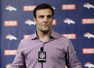 Photo - Newly acquired Denver Broncos wide receiver Wes Welker speaks at an NFL football news conference announcing his $12 million, two-year contract, Thursday, March 14, 2013, in Englewood, Colo. (AP Photo/Ed Andrieski) ORG XMIT: COEA105