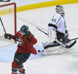 photo -   Minnesota Wild's Darroll Powe, left, celebrates his goal off Los Angeles Kings' Jonathan Bernier, right, in the first period of an NHL hockey game on Saturday, March 31, 2012, in St. Paul, Minn. (AP Photo/ Jim Mone)