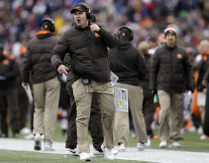 Photo - Cleveland Browns head coach Rob Chudzinski shouts instructions in the second quarter of an NFL football game against the New England Patriots, Sunday, Dec. 8, 2013, in Foxborough, Mass. (AP Photo/Steven Senne)