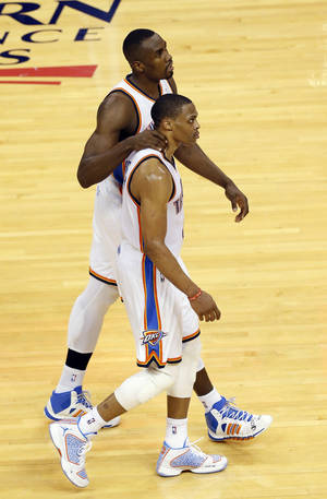 Photo - Oklahoma City's Serge Ibaka (9) and Russell Westbrook (0) celebrate at the end of the half during Game 3 of the Western Conference Finals in the NBA playoffs between the Oklahoma City Thunder and the San Antonio Spurs at Chesapeake Energy Arena in Oklahoma City, Sunday, May 25, 2014. Photo by Nate Billings, The Oklahoman