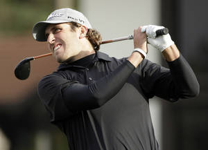 Photo - Andrew Loupe follows his drive from the 15th tee of the Monterey Peninsula Country Club Shore Course during the first round of the AT&T Pebble Beach Pro-Am golf tournament on Thursday, Feb. 6, 2014, in Pebble Beach, Calif. (AP Photo/Eric Risberg)