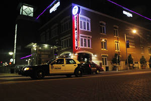 Photo - An Oklahoma City police car partrols the Bricktown area in Oklahoma City, Saturday, March 24, 2012.  There have been several assaults near bars in Bricktown the last eight months.  Photo by Garett Fisbeck, For The Oklahoman
