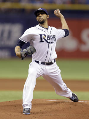 Photo - Tampa Bay Rays starting pitcher David Price delivers to New York Yankees' Derek Jeter during first inning of a baseball game on Thursday, April 17, 2014, in St. Petersburg, Fla. (AP Photo/Chris O'Meara)