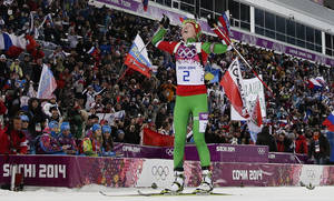 Photo - Belarus' Darya Domracheva celebrates winning the gold medal in the women's biathlon 12.5k mass-start, at the 2014 Winter Olympics, Monday, Feb. 17, 2014, in Krasnaya Polyana, Russia. (AP Photo/Felipe Dana)
