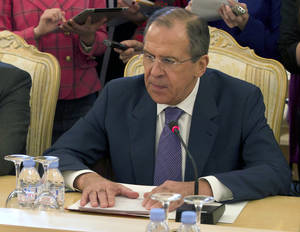 Photo - FILE- Russian Foreign Minister Sergey Lavrov, lays his hands on the table during talks with Thailand's Foreign Minister, not pictured, in Moscow, Russia, in this file photo dated  Thursday, March 28, 2013.  Lavrov on Friday April 5, 2013, is demanding an explanation for the North Korean warning that it can't guarantee the safety of embassies in its capital of Pyongyang in the event of a conflict, asking whether the warning is an order to evacuate their embassy or merely a suggestion that they should consider doing so. North Korea's government did not comment on the request for clarification.  (AP Photo/Ivan Sekretarev, File)