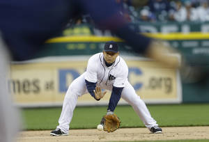 Photo - Detroit Tigers third baseman Miguel Cabrera fields an out from Minnesota Twins' Jamey Carroll during the first inning of a baseball game in Detroit, Thursday, May 23, 2013. (AP Photo/Carlos Osorio)