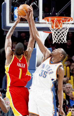 Photo - The Thunder's Kevin Durant blocks a shot from Houston's Trevor Ariza during the Thunder's 100-91 loss on Sunday. PHOTO BY SARAH PHIPPS, THE OKLAHOMAN