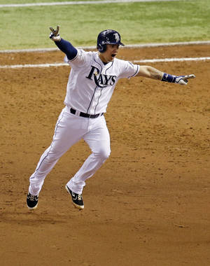 Photo - Tampa Bay Rays' Jose Lobaton celebrates a ninth inning home run against the Boston Red Sox to win Game 3 of an American League baseball division series in St. Petersburg, Fla., Monday, Oct. 7, 2013. Tampa Bay Rays won the game 5-4. (AP Photo/John Raoux)
