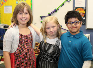 Photo -  Elora Johnson, Ciara Newberry and Neel Mandal, second-graders at John Ross Elementary, won a national science competition for their idea for a warning system for when a car's interior becomes too hot for a child or a pet. PHOTO BY ANNE SCHMIDT, EDMOND LIFE AND LEISURE  <strong></strong>
