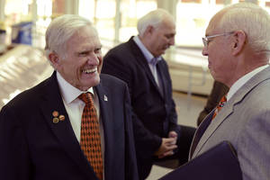 photo - Oklahoma State Universitys Bob Westerman, left, smiles during a a reception honoring his accomplishments.  Photo by Todd Johnson