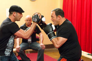 "Photo - Mark Dellagrotte training Scott Voss (Kevin James) with Niko (Bas Rutten) looking on in Columbia Pictures' ""Here Comes the Boom."" Sony Pictures Entertainment. <strong>Tracy Bennett</strong>"