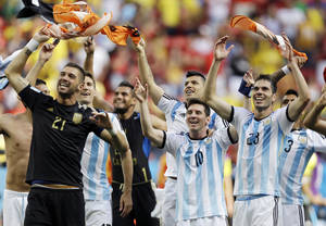 Photo - Argentina's Lionel Messi (10) and his teammates celebrate following their 1-0 victory over Belgium to advance to the semifinals after the World Cup quarterfinal soccer match at the Estadio Nacional in Brasilia, Brazil, Saturday, July 5, 2014. (AP Photo/Kirsty Wigglesworth)