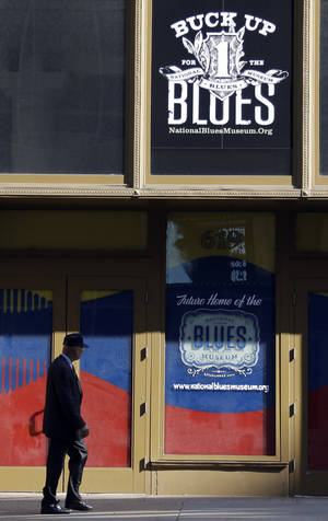 Photo - In this Wednesday, Sept. 25, 2013 photo, a man walks past past the site of the National Blues Museum, set to open next year, in St. Louis. Casual Blues fans may not immediately think of St. Louis when considering the genre, but organizers of the project say the city has its own rich musical history making it a deserving home for the national museum. (AP Photo/Jeff Roberson)