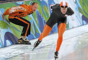 Photo - FILE - In this Feb. 23, 2010 file photo Dutch coach Gerard Kemkers, left,  encourages Netherland's Sven Kramer, right, during the men's 10,000 meter speed skating race at the Richmond Olympic Oval at the Vancouver 2010 Olympics in Vancouver, British Columbia. Gerard Kemkers sent Kramer into the wrong lane on a changeover. Gone was the chance for triple gold and the opportunity to become one of the top stars of the Olympics. With the same coach still at his side, the dominating Dutchman plans to show in Sochi 2014 how you bounce back from the darkest moment of his career. 'He will only get over it, if he gets gold on the 10K in Sochi,' said Geert Kuiper, a trainer of Kramer in a telephone interview with The Associated Press. (AP Photo/Chris Carlson, File)